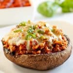 Turkey Stuffed Portobello Mushrooms with Marinara & Cheese (Low Carb, Gluten-free) - These turkey stuffed portobello mushrooms with marinara and cheese make an easy, healthy main dish. Naturally low carb and gluten-free.