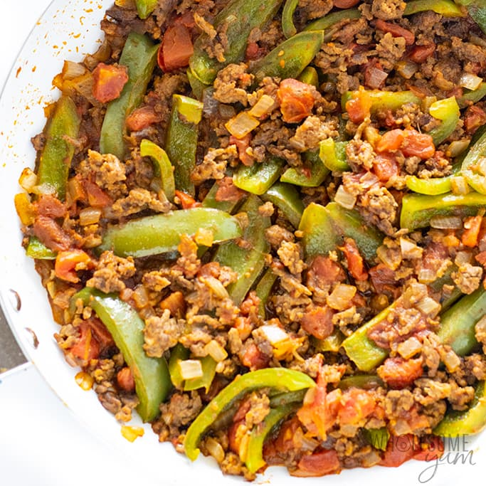 taco skillet dinner with beef, onions, peppers, and tomatoes