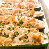 These buffalo chicken stuffed zucchini boats are spicy, savory, low-carb, and gluten free. A perfect single-pan dinner that's so many great things in one.