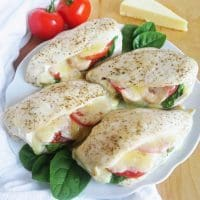 This cheesy, juicy stuffed chicken with spinach and tomatoes is naturally low carb, gluten-free, and uses just a few basic ingredients.