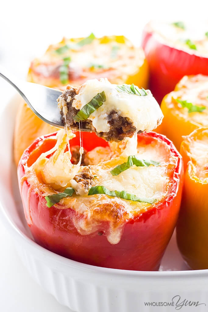Low Carb Lasagna Stuffed Peppers - 7 Ingredients (Gluten-free) - This easy, gluten-free, low carb stuffed peppers recipe is like a cheesy ground beef lasagna packed into sweet bell peppers. The low carb lasagna ever!