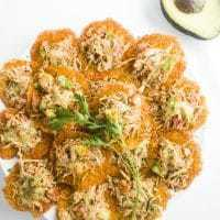 This low carb nachos recipe is made with cheddar cheese and smothered with a spicy taco seasoned chicken topping. Naturally gluten-free.