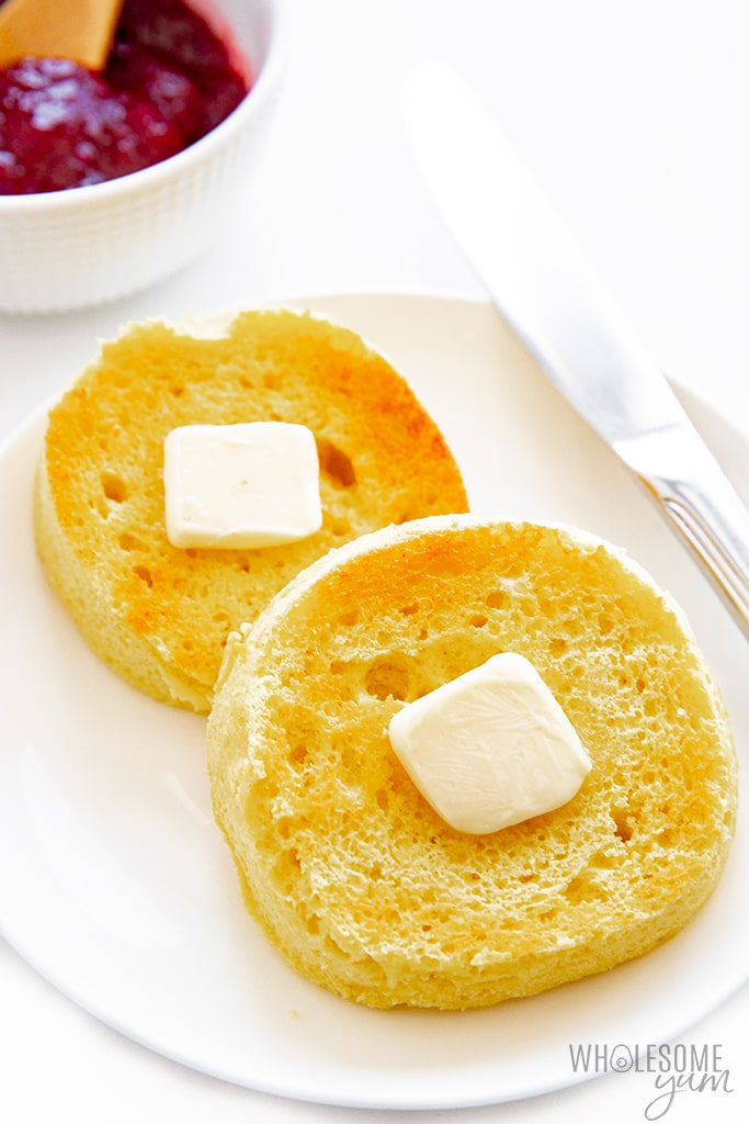 Gluten-free English muffins on a plate with butter