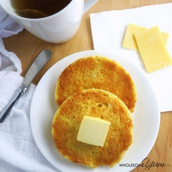 Low carb English muffin with pat of butter on a plate