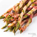 Crispy Bacon Wrapped Asparagus Recipe in the Oven - This easy bacon wrapped asparagus recipe in the oven includes tricks for extra crispy bacon. Everyone loves these easy asparagus and bacon appetizers. And, bacon wrapped asparagus is naturally low carb, keto, paleo, and whole30 friendly.