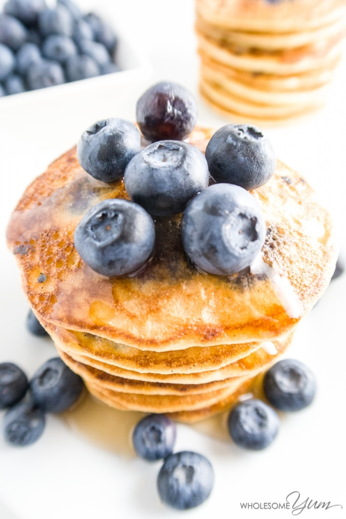 Blueberry Vanilla Bean Almond Flour Pancakes (Paleo, Low Carb) - These fluffy almond flour pancakes are studded with vanilla bean specks and fresh blueberries. Paleo, low carb, and gluten-free.