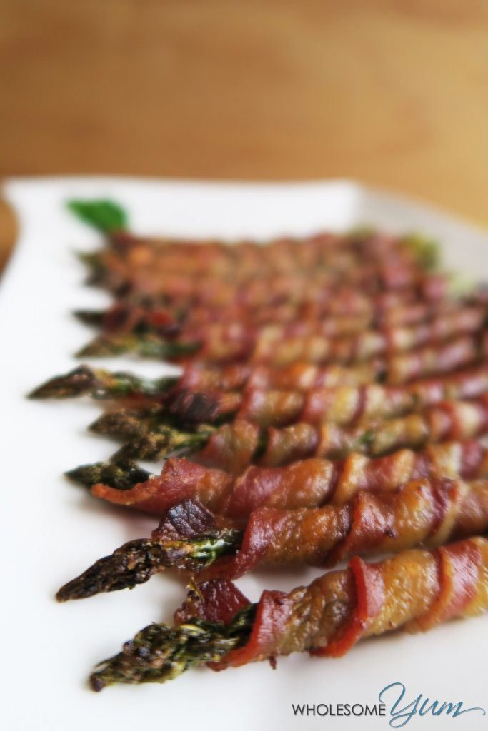 Bacon Wrapped Asparagus Recipe in the Oven (Crispy, Paleo & Low Carb) - This easy bacon wrapped asparagus recipe is baked in the oven, with some tricks for extra crispy bacon. Everyone loves these easy asparagus and bacon appetizers. They're naturally paleo and low carb, too. Ready in just 30 minutes!