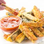 Crispy Baked Zucchini Fries Recipe - Low Carb with Parmesan - Crispy oven baked zucchini fries made with just 5 INGREDIENTS! Everyone will love this easy and healthy low carb Parmesan zucchini recipe. These make great keto fries, too.