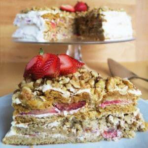 Medovik Cake Recipe with Strawberries (Low Carb, Gluten-free) - This Russian medovik honey cake recipe is layered with cream filling, honey nut pastry, fresh strawberries, and walnuts. A healthier, gluten-free version!
