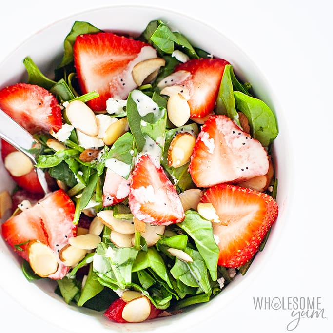strawberry spinach salad with poppy seed dressing in a bowl