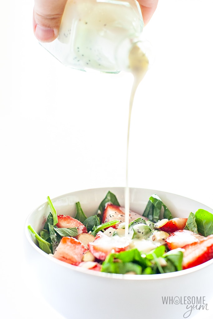 strawberry poppyseed salad with dressing drizzle