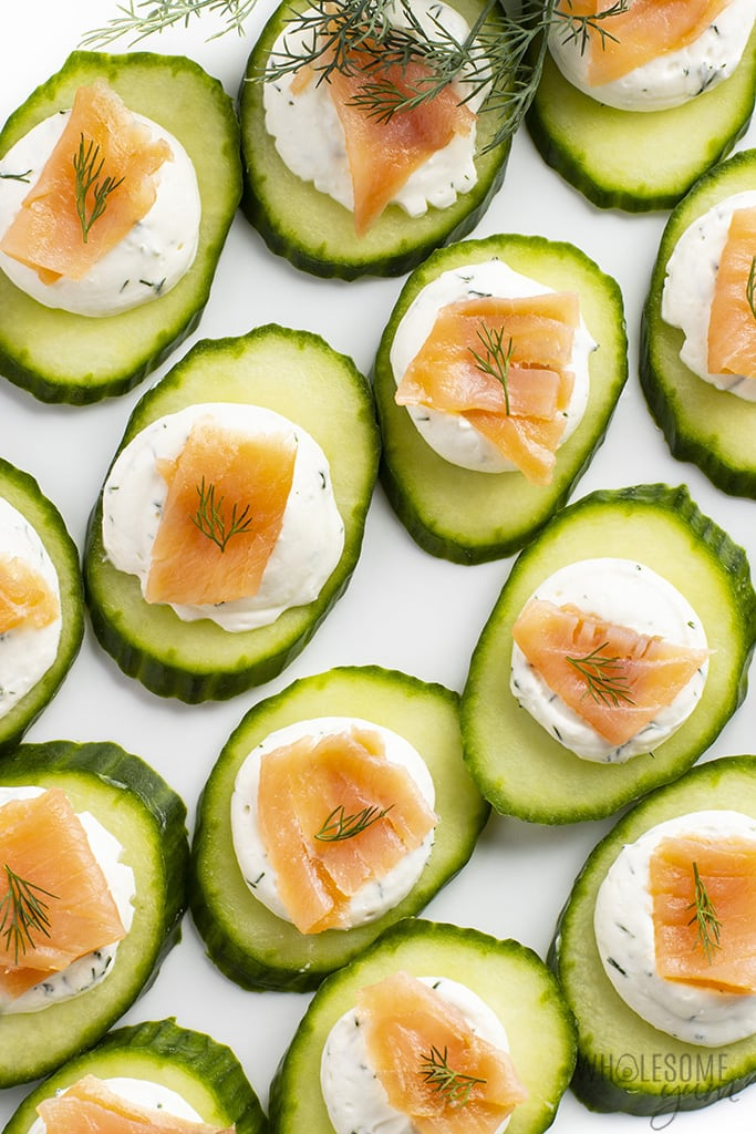 Smoked salmon cucumber bites with cream cheese, arranged in rows
