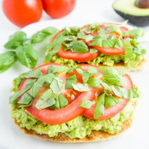 Tomato Basil Avocado Toast (Paleo, Low Carb) - This low carb, paleo toast is all about the flavors of spring and summer - creamy avocado, juicy tomatoes, and fresh basil.