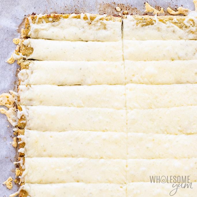 Cheesy cauliflower breadsticks in pan