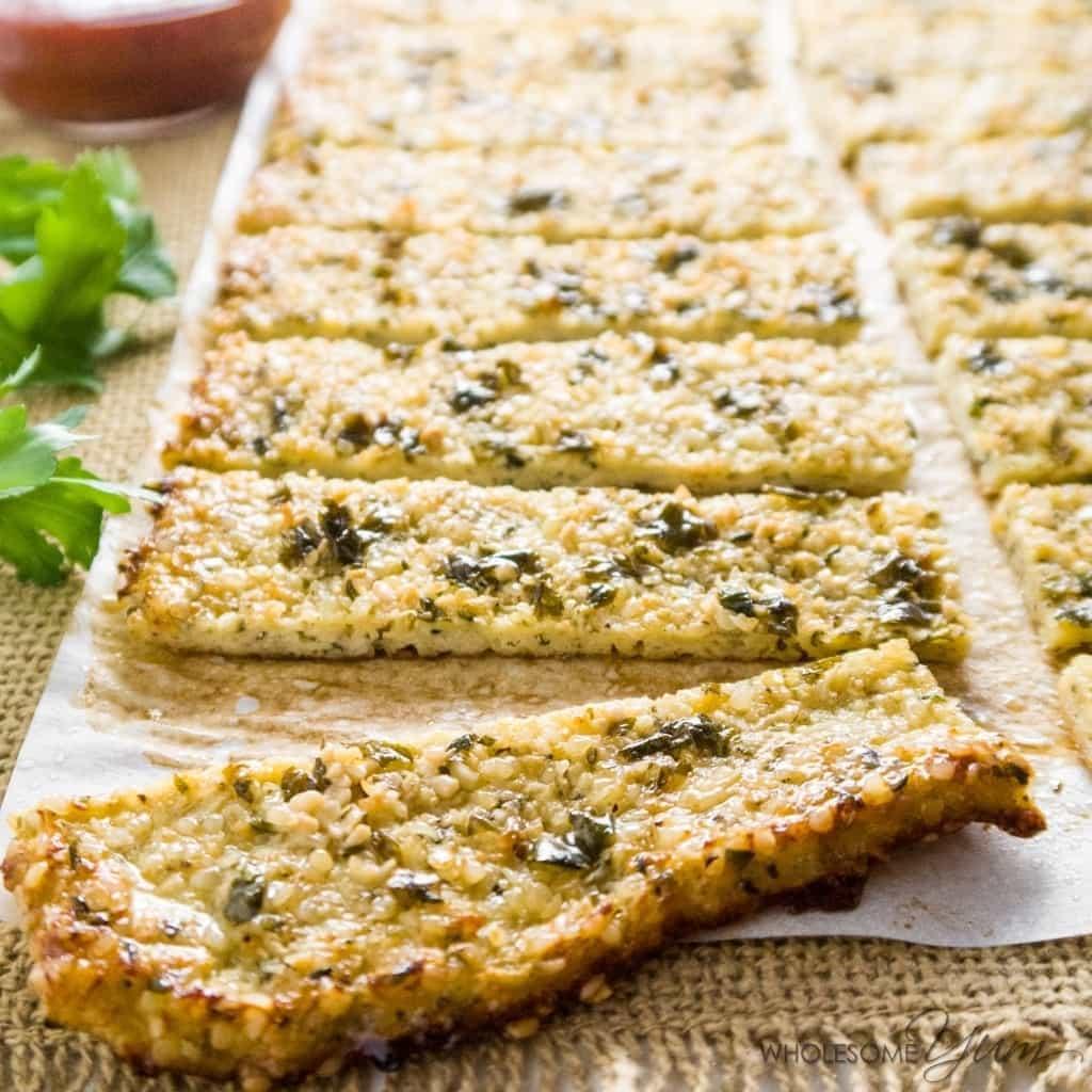 Low Carb Cauliflower Breadsticks with Garlic Butter & Hemp Seeds (Paleo, Gluten-free) - These crispy, low carb cauliflower breadsticks are low carb and paleo. Garlic butter and hemp seeds provide plenty of flavor. Gluten-free, healthy & easy!