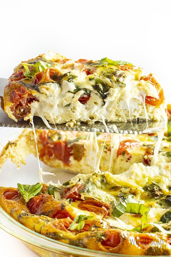 slice of quiche caprese with oozing cheese