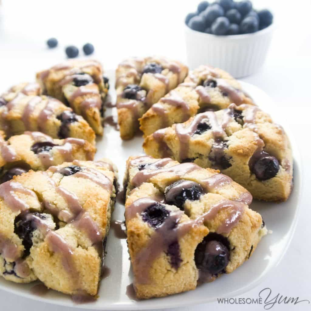 These paleo, low carb scones are bursting with juicy fresh blueberries and topped with a natural blueberry glaze. Can't beat gluten-free blueberry scones!