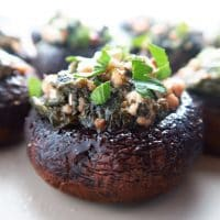 This simple spinach stuffed mushrooms recipe with feta & garlic is like an easier, healthier version of Greek spanakopita. Naturally low carb & gluten-free. Only 8 ingredients!