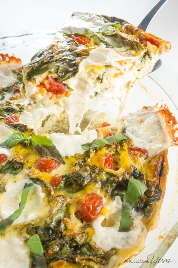 Low Carb Crustless Quiche Caprese (Gluten-Free) - This 8-ingredient low carb crustless quiche Caprese is packed with summer flavors and gooey cheese. Naturally gluten-free, too!