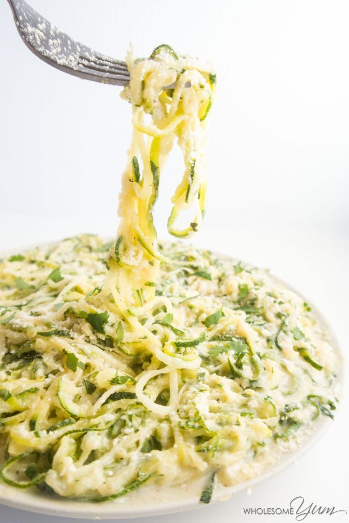 keto zoodles with alfredo sauce on fork
