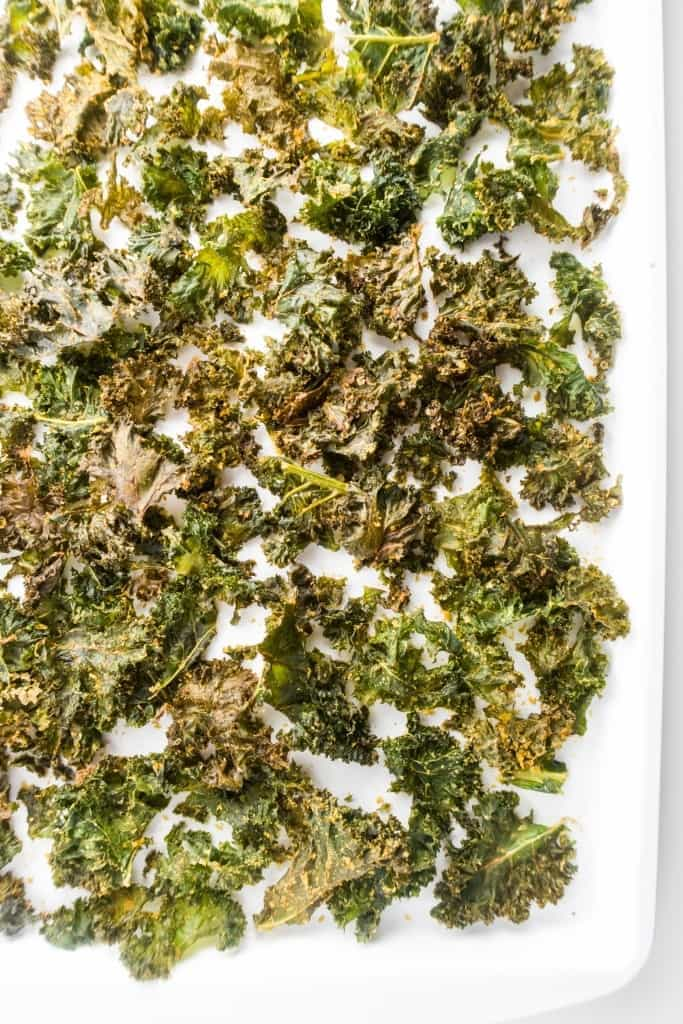"5-Ingredient Salt and Vinegar Kale Chips (Paleo, Low Carb) - This ""cheesy"" salt and vinegar kale chips recipe is naturally low carb, paleo, gluten-free, vegan, and unbelievably easy to make. Only 5 ingredients!"