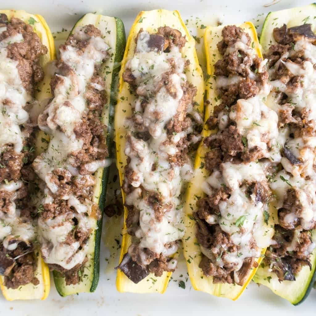 These easy stuffed summer squash boats are made with yellow squash & zucchini. They're packed with gooey Swiss cheese, ground beef & shiitake mushrooms.