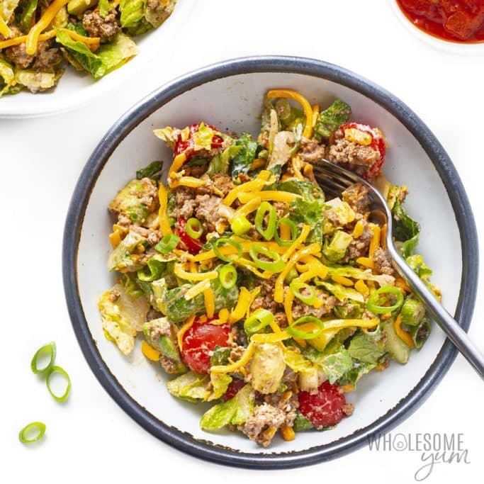 Beef taco salad in a bowl with fork