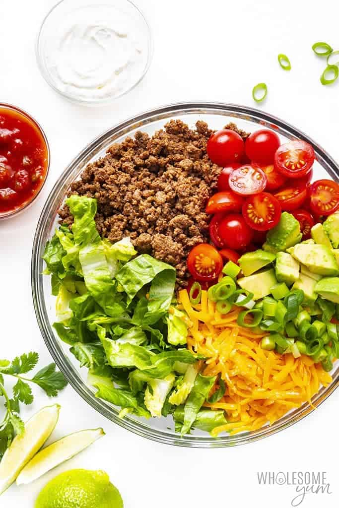 Taco salad bowl with ingredients separated