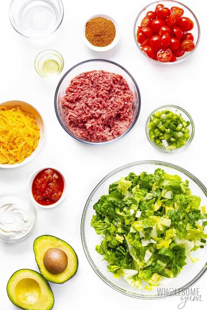 Taco salad ingredients in bowls