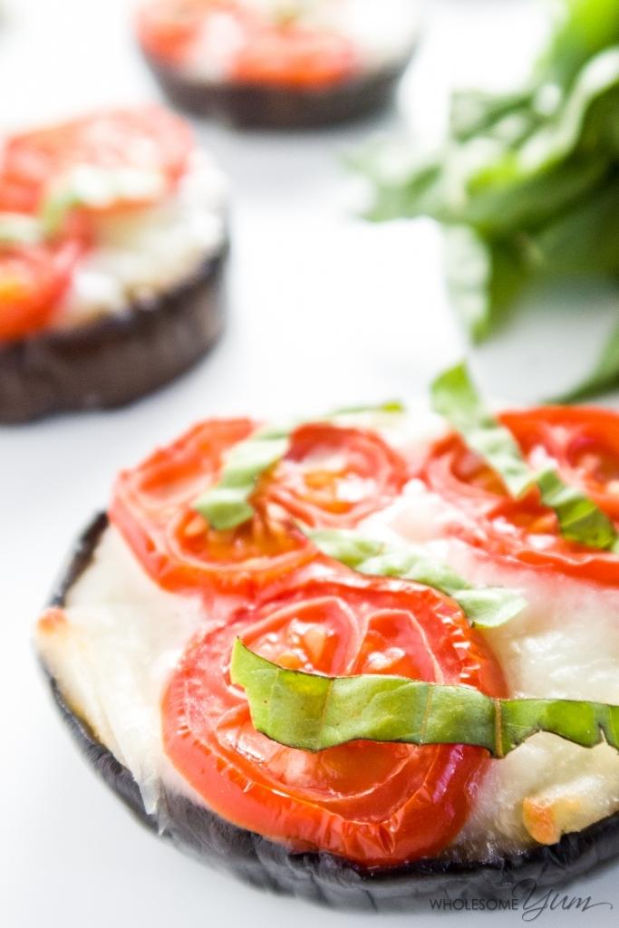 Eggplant Pizza - Margherita Style (Low Carb, Gluten-free) - This easy, low carb eggplant pizza recipe is bursting with aromatic garlic, cherry tomatoes, gooey mozzarella & fresh basil. Healthy & gluten-free, too.