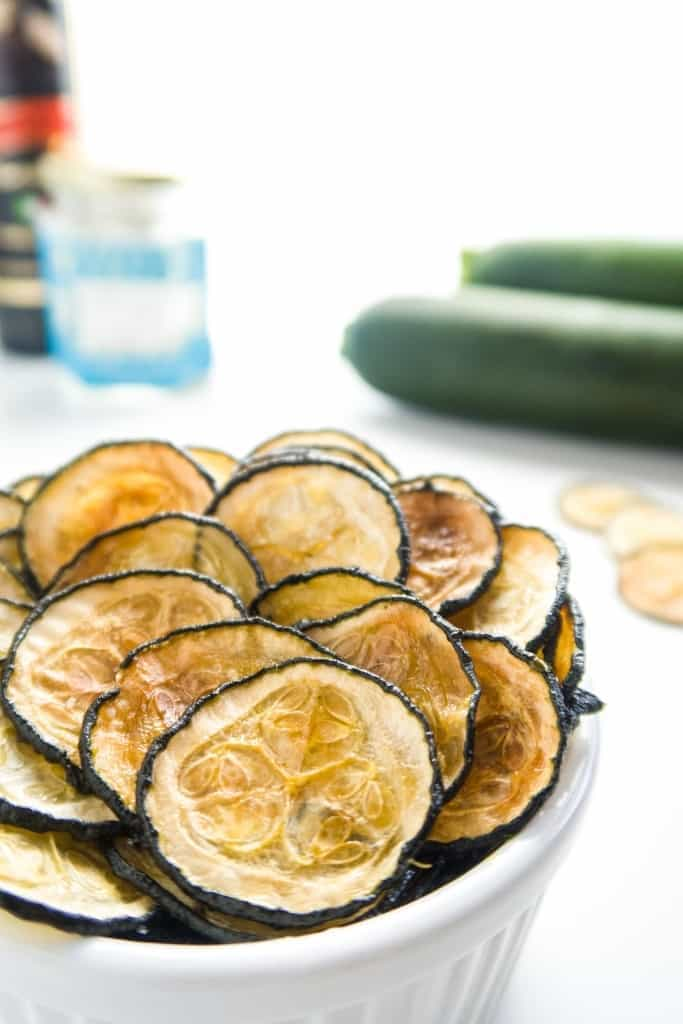 How To Make Zucchini Chips with Truffle Salt (Paleo, Low Carb) - This baked zucchini chips recipe is so easy! Learn how to make zucchini chips even better with truffle salt. Naturally low carb, gluten-free, and paleo.