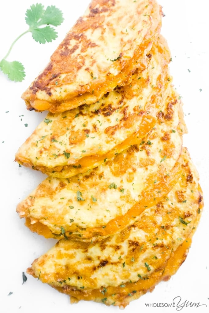 These spicy, gluten-free, and low carb quesadillas are made with sharp cheddar cheese, a creamy homemade jalapeno sauce & tortillas made from cauliflower.