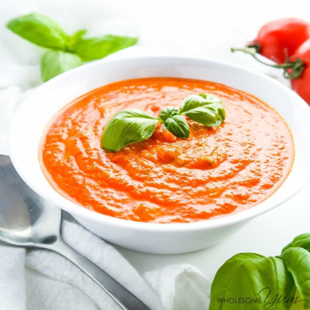 5-Ingredient Roasted Tomato Soup (Low Carb, Gluten-Free) - This easy 5-ingredient soup is bursting with roasted tomatoes and fresh basil. Low carb, gluten-free, grain-free, and keto, with a paleo option.