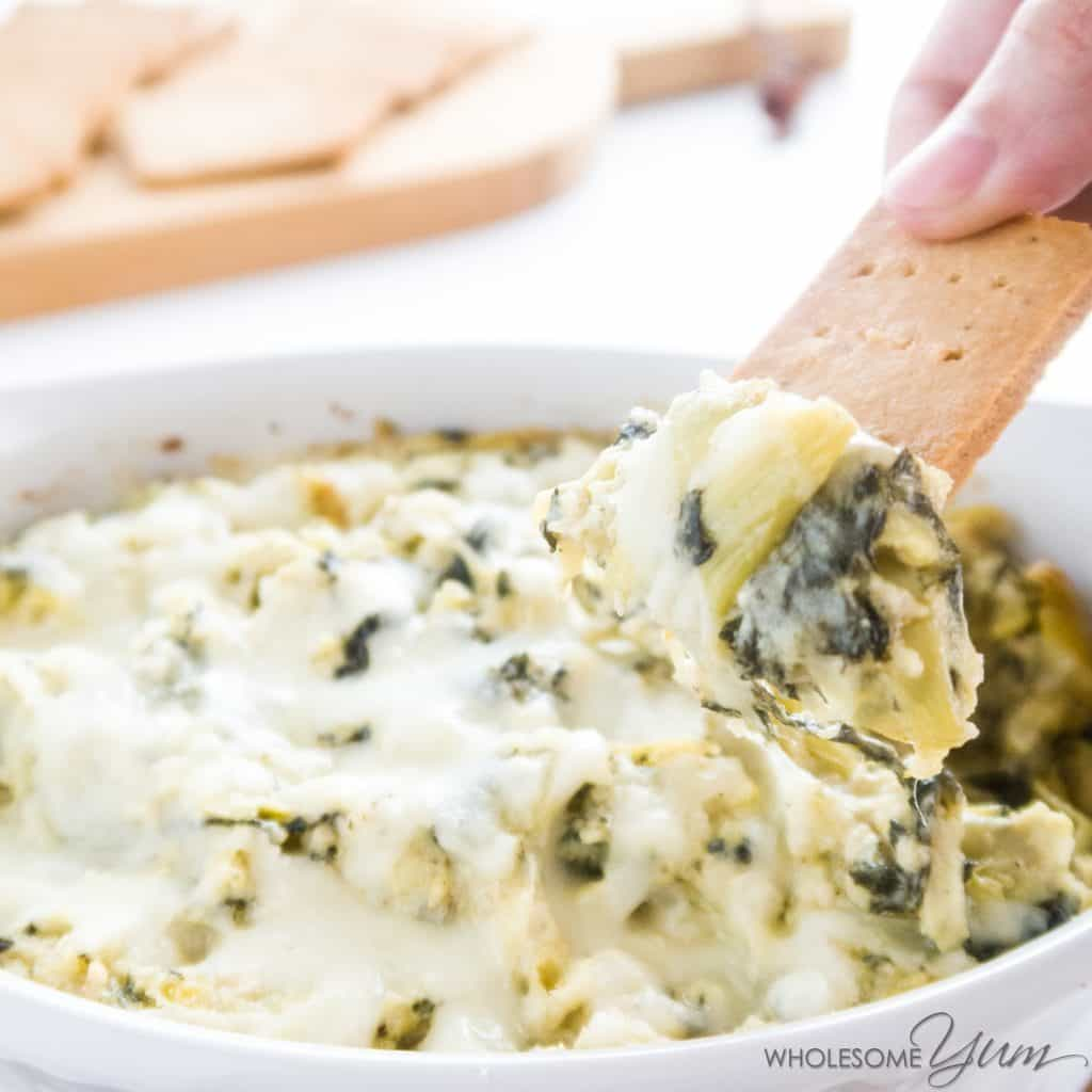 8-Ingredient Spinach Artichoke Dip (Low Carb, Gluten-free) - This hot, low carb spinach artichoke dip recipe is so easy and quick - just 10 minutes to prep. You won't believe it's healthy and gluten-free.