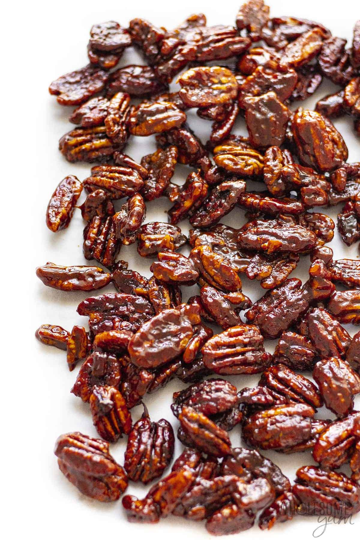 Sugar free candied pecans on a cutting board