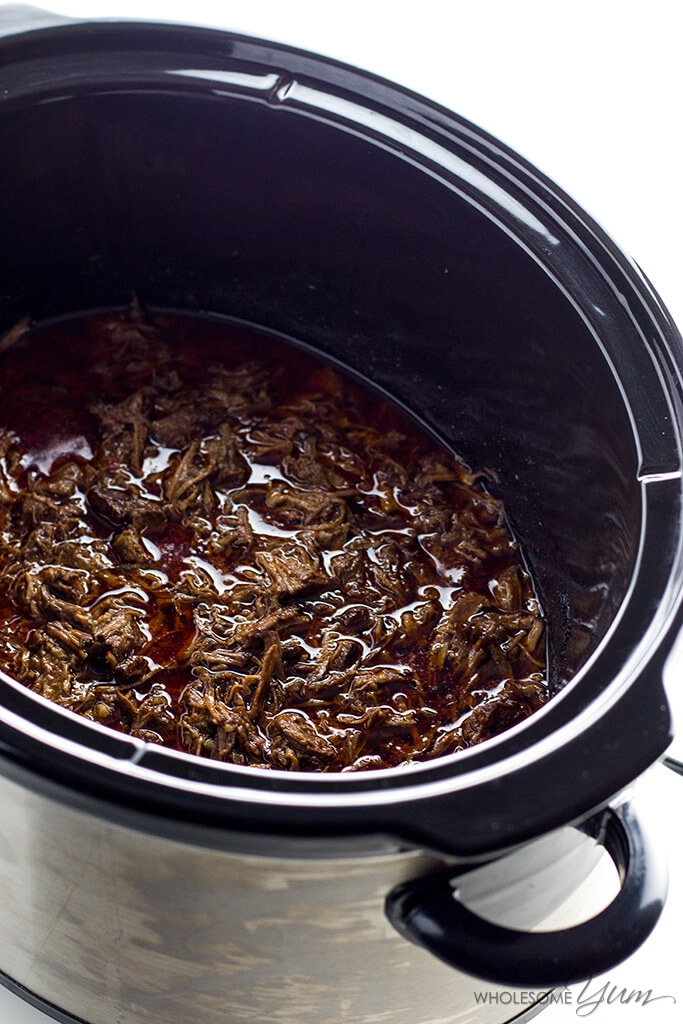 This copycat Chipotle barbacoa recipe is made in a slow cooker (Crockpot) using only 10 ingredients. Healthy, easy, naturally low carb, paleo & gluten-free.