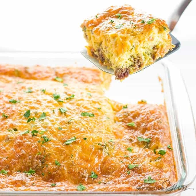 This cheesy, 6-ingredient low carb breakfast casserole recipe with sausage is so easy! Naturally gluten-free & simple to customize by adding vegetables.