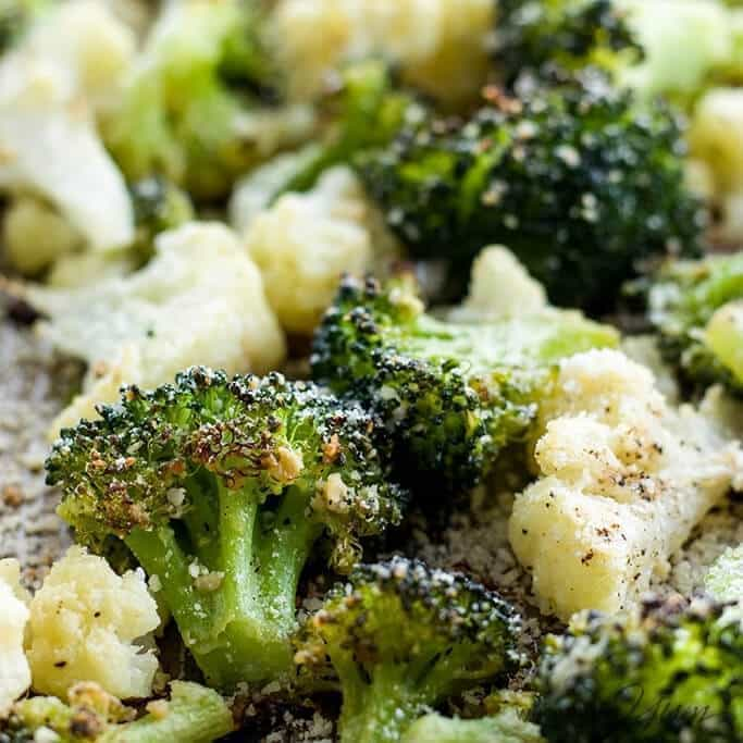 This healthy roasted broccoli and cauliflower recipe with parmesan and garlic is quick and easy with just 5 ingredients. A delicious way to serve veggies!