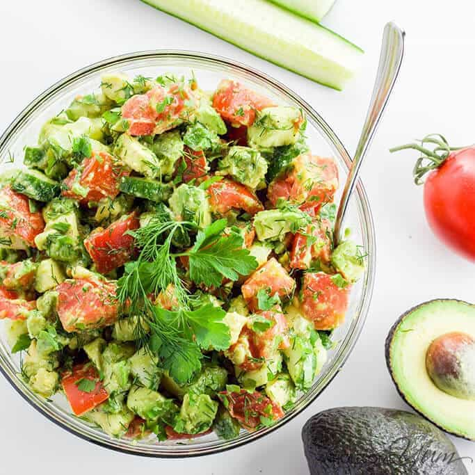 This healthy cucumber tomato avocado salad recipe with fresh herbs is quick, easy, and perfect for any time of year.