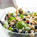 This easy spring mix salad recipe with blueberries, goat cheese, and walnuts comes with a blueberry vinaigrette dressing. Just 5 minutes to make!