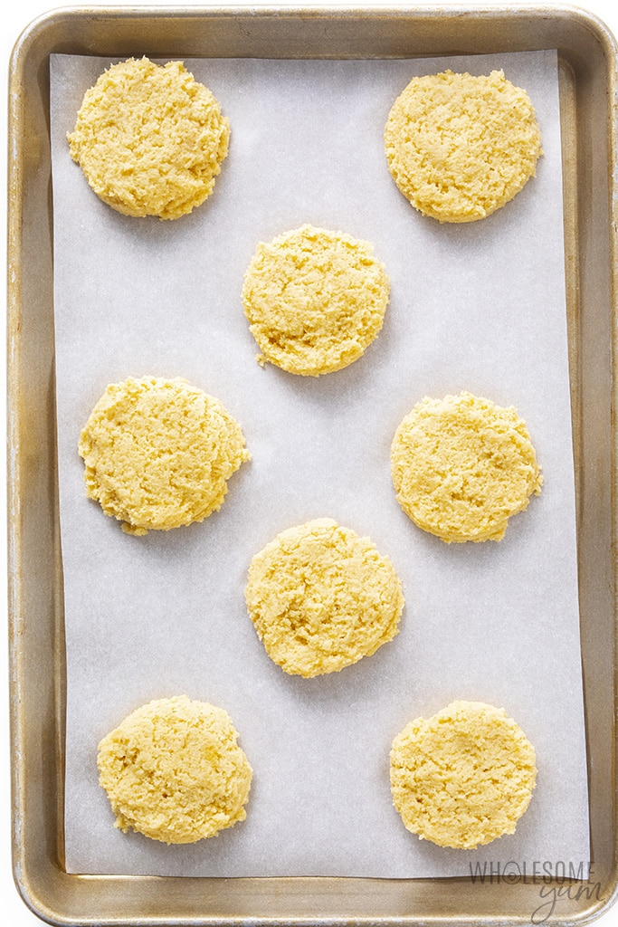 Almond flour biscuits on a sheet pan before baking