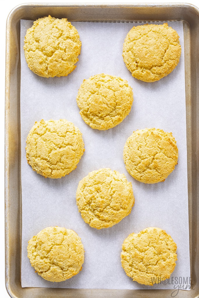 Baked almond flour biscuits on a sheet pan