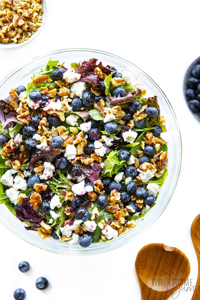 Spring mix salad with blueberries and goat cheese in a bowl