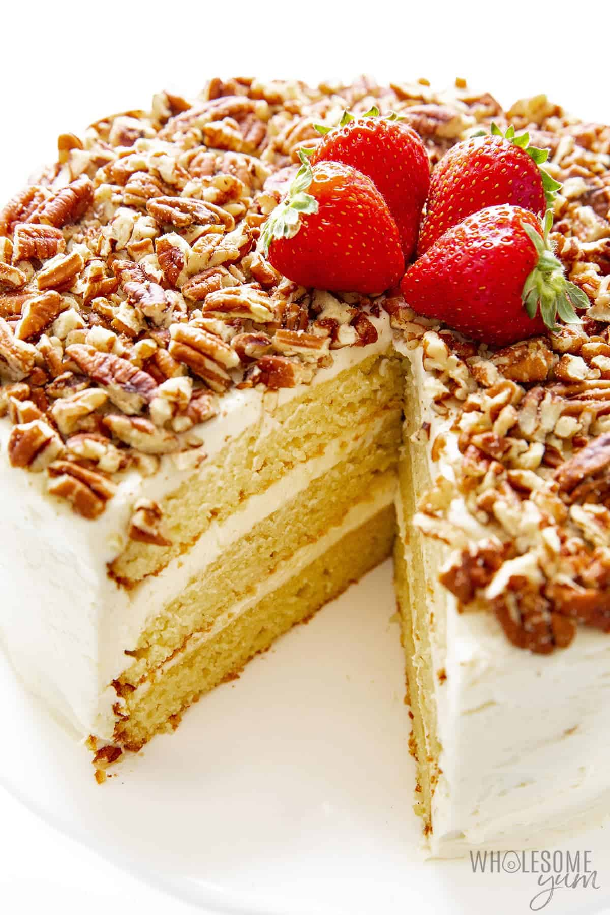Sugar free vanilla cake topped with pecans and strawberries