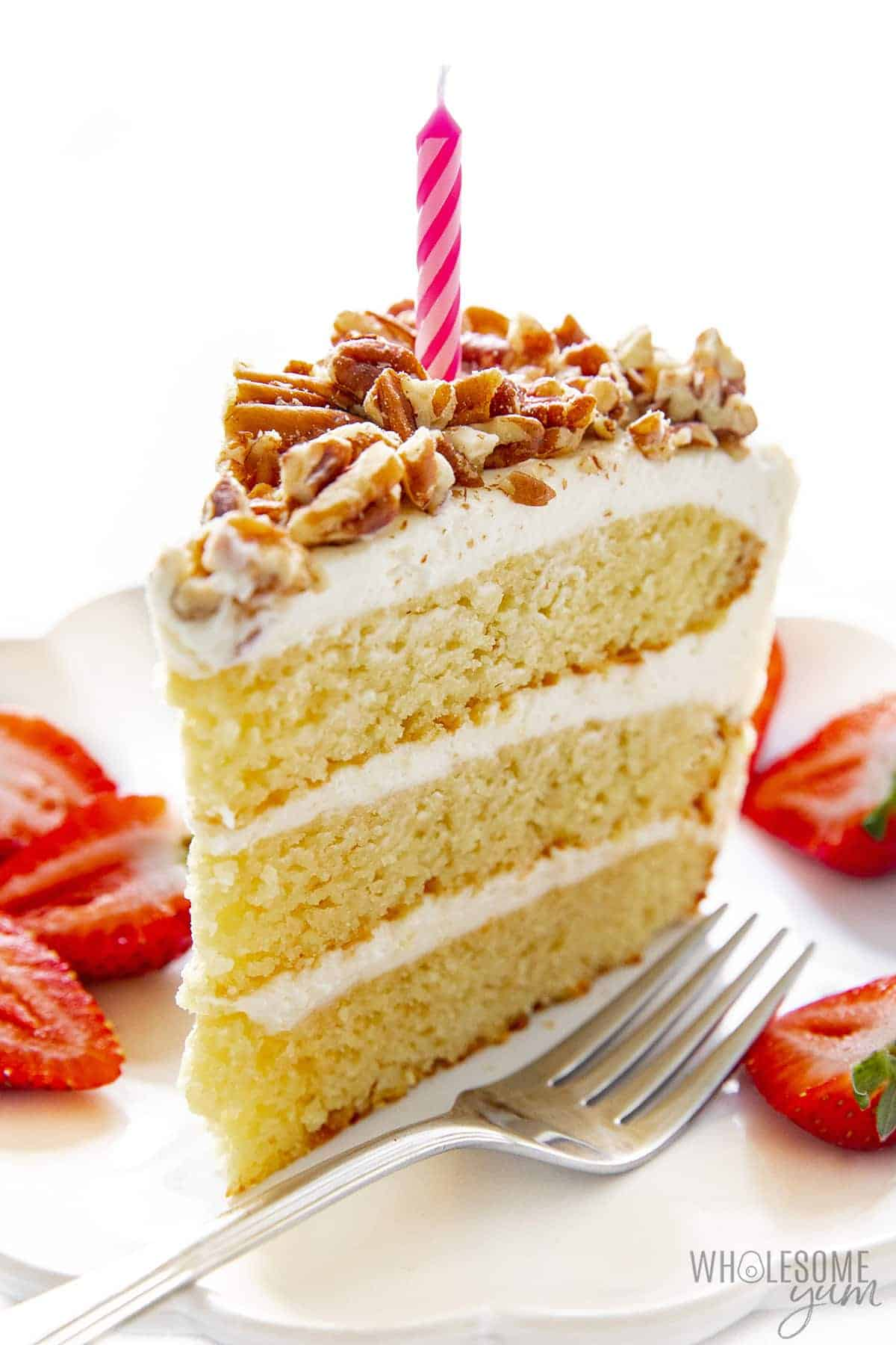Slice of sugar free birthday cake with candle