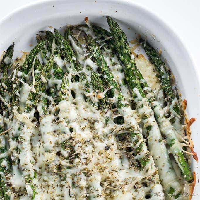 This baked cheesy asparagus recipe needs just 5 ingredients and is ready in 20 minutes. The perfect easy, healthy side dish! Low carb and gluten-free.
