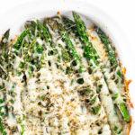 cheesy asparagus in a stoneware dish