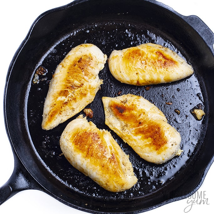 Browned chicken breast in a skillet