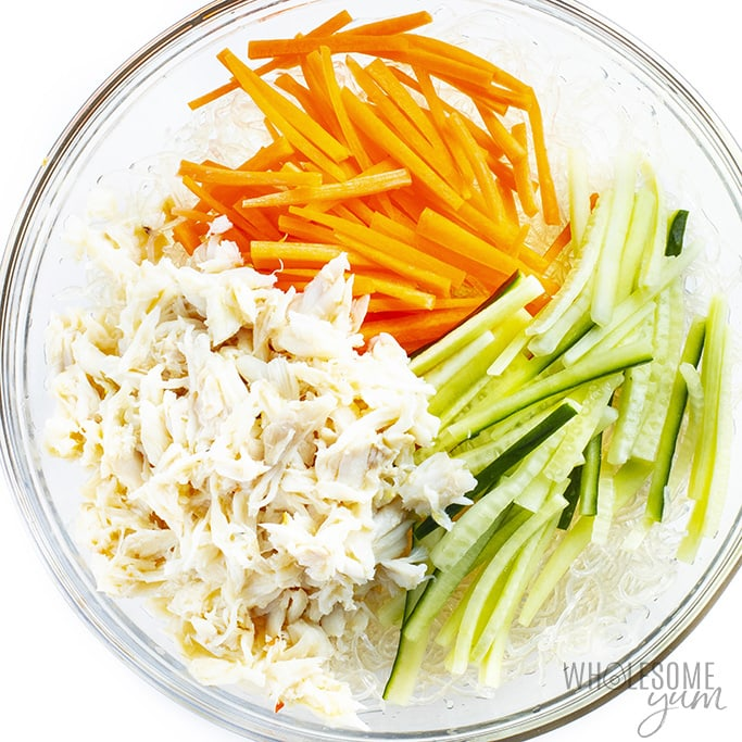 Kani salad ingredients without dressing in a glass bowl
