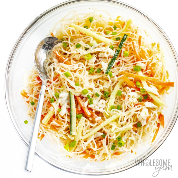 Kani salad tossed with garnishes on a plate